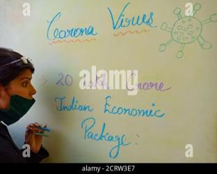 DISTRICT KATNI INDIA MAY 17 2020: An indian teacher displayed self depended india concepts on light color board wearing face mask Stock Photo Alamy