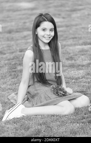 green grass small girl with long brunette