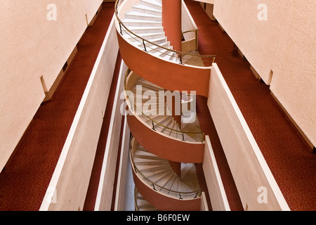 Corridor and spiral staircase, stairs inside Hotel Banyan