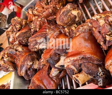 Pigs feet on the food market Luang Prabang Laos