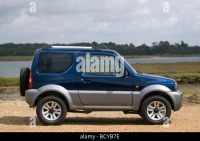 Suzuki jimny 4x4 off road hire car by a lake in ...