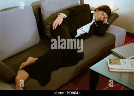 sleeping couch and sofa cape town design a uk young businesswoman with feet on desk stock photo ...