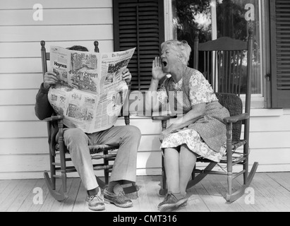 old lady chair plastic covers for recliners 1970s elderly couple in rocking chairs on porch holding hands stock photo, royalty free image ...