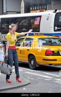 USA, New Jersey, Jersey City, Blonde woman braiding hair ...