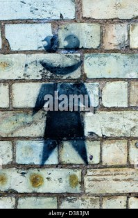 A graffiti spray painted brick wall using red black and ...