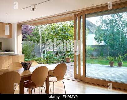 View Through Glass Patio Doors To Courtyard Garden With