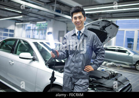 Man Working On Car By Flashlight Mechanic Fixing Auto