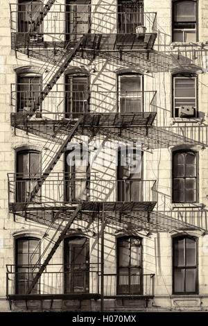 Typical New York City apartment building with fire escapes on the Stock Photo 88153430  Alamy