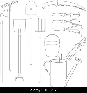 Garden tools spade hoe forks and rakes leaning against an