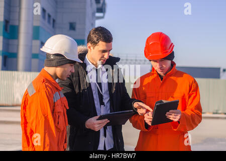 Group of engineers meeting on building roof Stock Photo