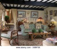 Sofas and coffee tables in rustic living room Stock Photo ...