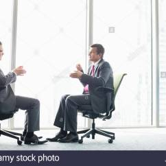 Office Sitting Chairs Farmhouse Kitchen Full Length Side View Of Businessmen Discussing While On By Window