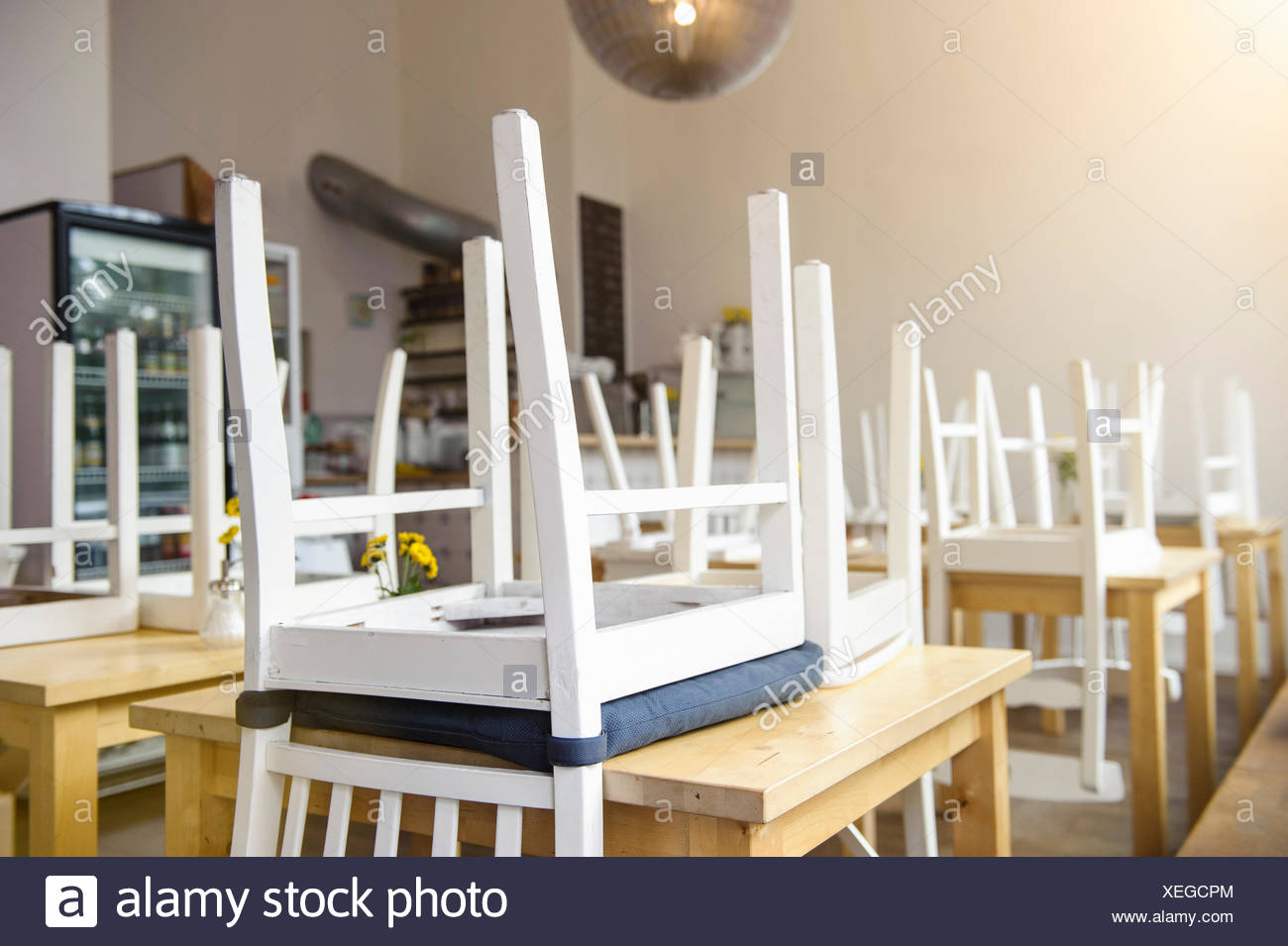 chair upside down on wall memory foam kitchen pads the table stock photos and