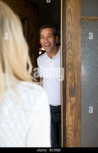 Woman Opening Front Door Man Stock Photos & Woman Opening