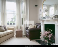 Brown Leather Sofa Fireplace Stock Photos & Brown Leather ...