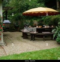 Patio Table With Parasol Stock Photos & Patio Table With ...