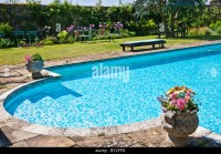 Lawn Chairs And Swimming Pool Stock Photos & Lawn Chairs ...