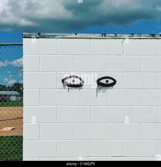 Graffiti Spray Painted On White Stock Photos & Graffiti