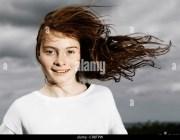 wind blowing girls hair stock