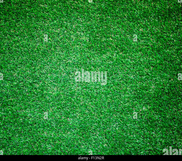 green synthetic grass sports field with white line stock photo