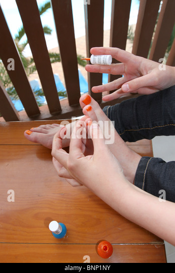 child pedicure chair power lift chairs reviews painting toes stock photos & images - alamy