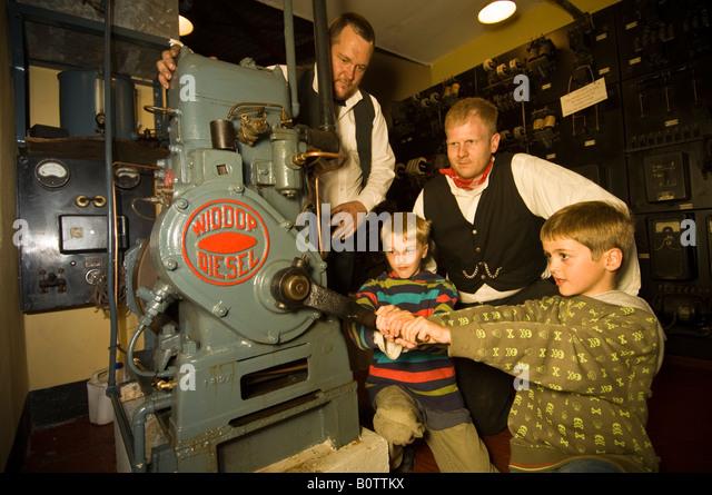 two-children-hands-on-working-an-old-diesel-engine-at-internal-fire-b0ttkx.jpg