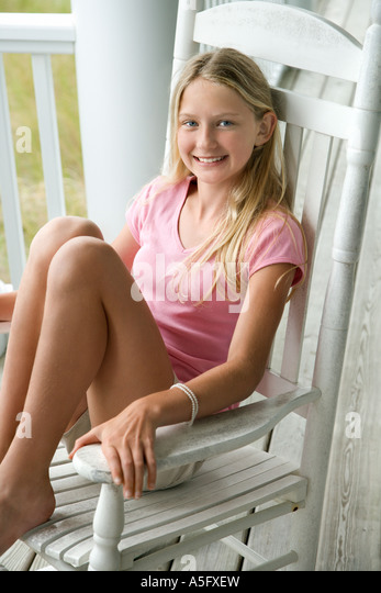 rocking chair christmas covers boone high girl sitting in stock photos & images - alamy