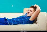 Teen Boy Sleeping On Couch Stock Photos & Teen Boy ...