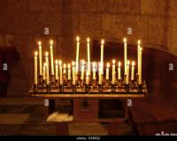 Rows Candles Lit In Church Stock Photos & Rows Candles Lit ...