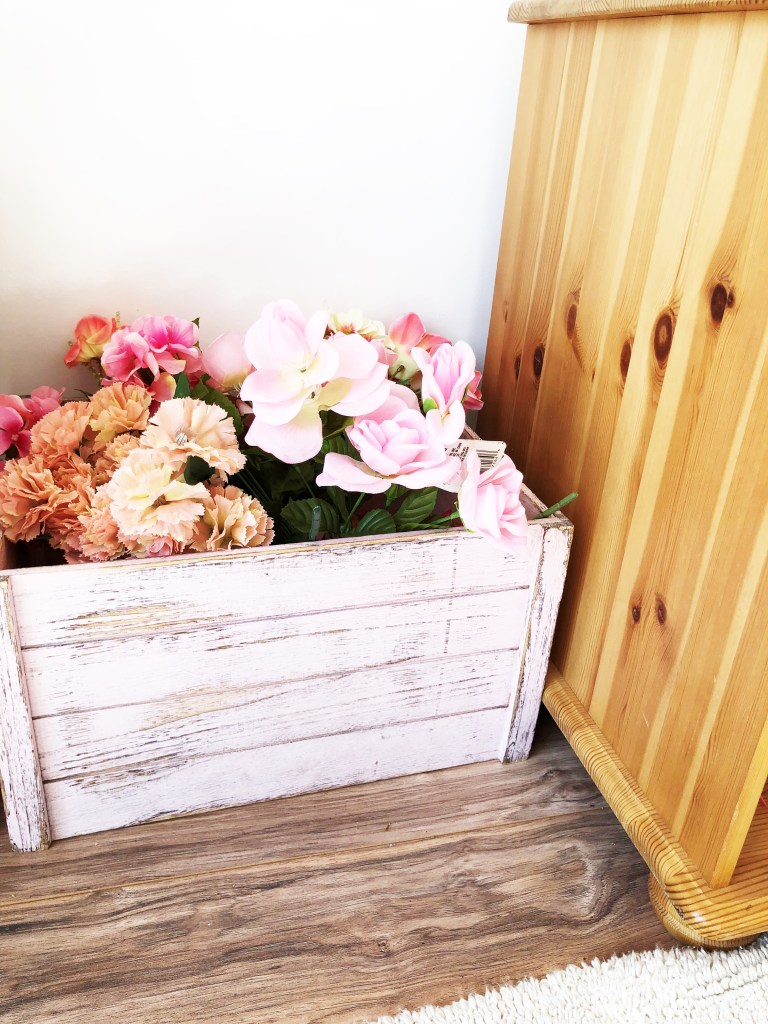 pink crate with florals