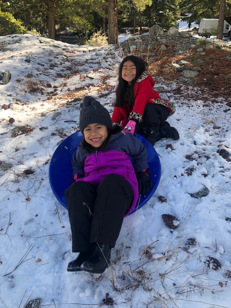 toddlers sledding