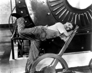 Chaplin, Les Temps Modernes By movie studio (ebay) [Public domain], via Wikimedia Commons