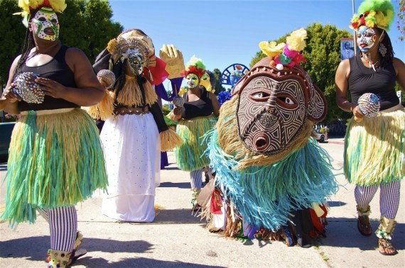 Mask festival procession in honor of the ancestors in Leimert Park. Sahra Sulaiman/Streetsblog L.A.