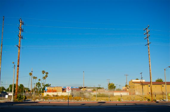 The sun sets on the vacant lot at 85th and Vermont, directly across the street from County Supervisor Mark Ridley-Thomas' Constituent Service Center. Sahra Sulaiman/Streetsblog L.A.