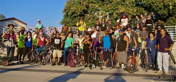 Black & Brown Unity Ride posts up at the Watts Towers. The ride began at Mariachi Plaza. Sahra Sulaiman/Streetsblog L.A.