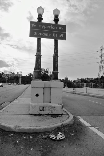 "Heading up the Glendale-Hyperion bridge into Silver Lake. Appropriately, the battered and painted over sign at the base of the lights reads ""DANGER.""  Sahra Sulaiman/LA Streetsblog"