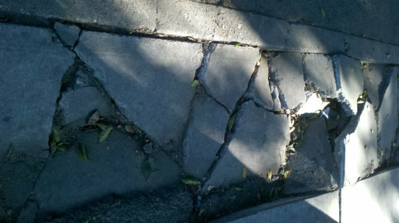 Broken sidewalk on Alameda Street in downtown Los Angeles. Photo: Roger Rudick