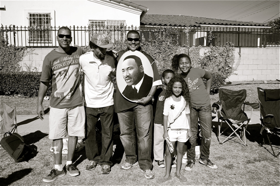 Families along Martin Luther King Blvd. celebrate at the King Day parade. Sahra Sulaiman/Streetsblog L.A.