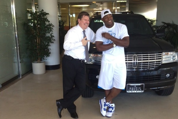 "Puig with his 2013 Lincoln Navigator. He leased this car to be ""less conspicuous."" Photo: ##http://www.edmunds.com/car-news/dodgers-sensation-yasiel-puig-goes-under-the-radar-with-2013-lincoln-navigator.html##Edmunds.com##"
