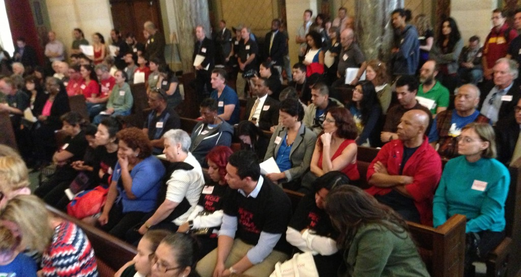 Overflow crowd at yesterday's anti-fracking hearing at the L.A. City Council PLUM Committee. South L.A. residents wearing their black and red People Not Pozos T-shirts in the foreground. Joe Linton/LA Streetsblog