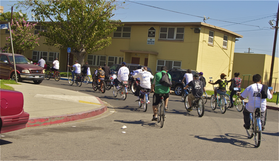 """The group rides through Nickerson Downs, a public housing development whose """"No Trespassing"""" signs -- likely posted to help keep residents safe -- also ensure that residents remain isolated. Sahra Sulaiman/LA Streetsblog"""