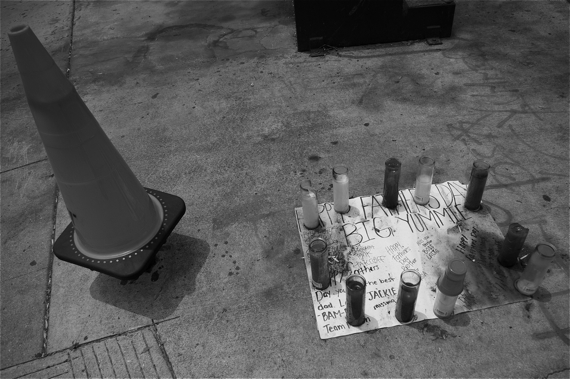 Candles and well-wishes mark the site where Big Yummie was killed in the Gonzaque (formerly the Haciendas) housing development. The candles are red to mark his affiliation with a set of the Bloods. Sahra Sulaiman/LA Streetsblog