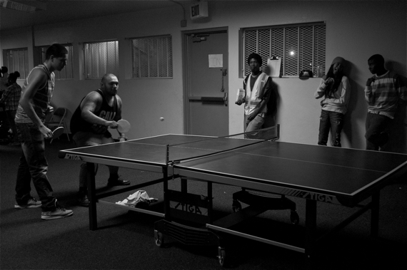 Workers from the Summer Night Lights program at Jordan Downs play an intense game of ping pong. The program is intended to keep at-risk youth safe and occupied in the summer, as there hardly any recreational opportunities for them in places like Watts. Sahra Sulaiman/LA Streetsblog