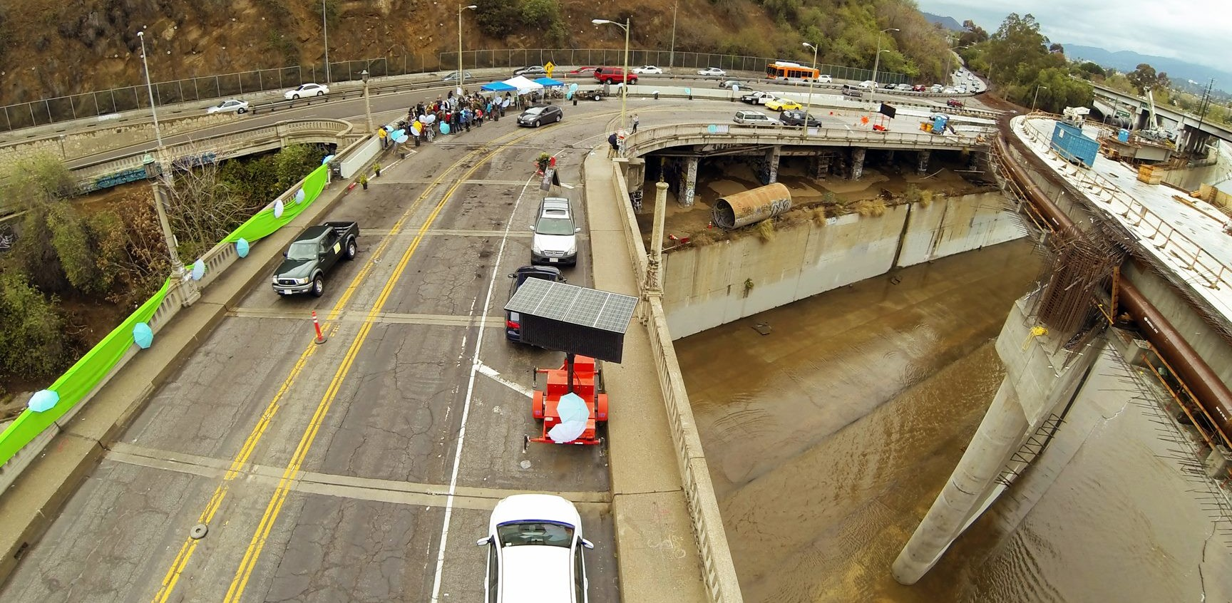 Landbridge proponents staged a pop-up party on the Riverside Figueroa Bridge over the Los Angeles River. The new replacement bridge is on the