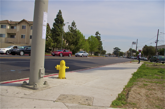The bus stop as of last Saturday, with new sidewalk and repainted (and perhaps upgraded) fire hydrant. Sahra Sulaiman/LA Streetsblog