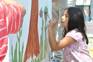 Linsay Rosales, 6, helps paint a electric box during a pop-up plaza event in Pacoima on April 19.