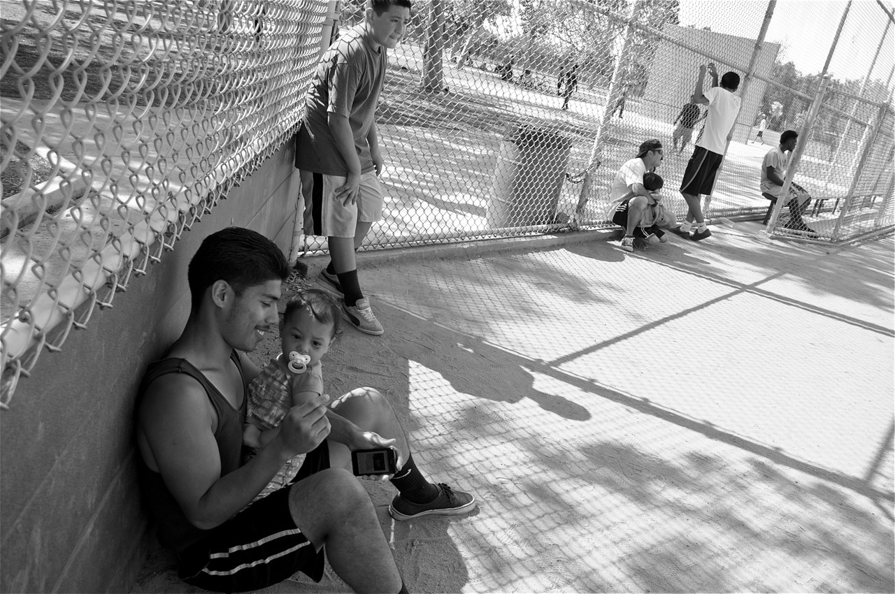 Jimmy and his daughter take a break from the kickball game. Sahra Sulaiman/LA Streetsblog