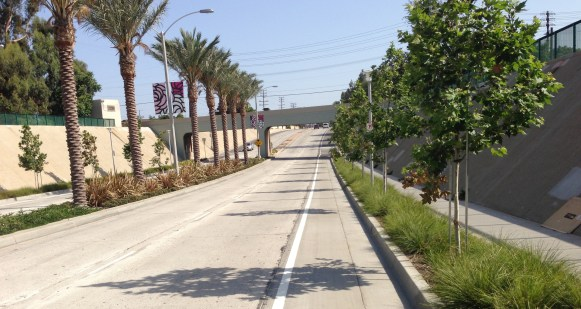 Heading southbound toward the railroad underpass at the southern end of Temple City. Extensive landscaping and curb-bike-lanes.