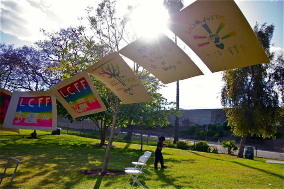 """Community-made art at the Saludarte festival in Hollenbeck Park. """"LCFF"""" stands for """"local control funding formula"""" and refers to an initiative that would give the community control over how local education funds are spent. Sahra Sulaiman/LA Streetsblog"""