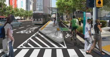 This rendering of the MyFigueroa project shows how protected bike lanes help prevent bus-bike conflict.